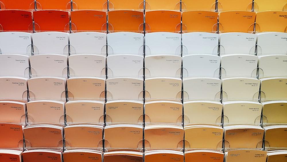 white and orange plastic chairs