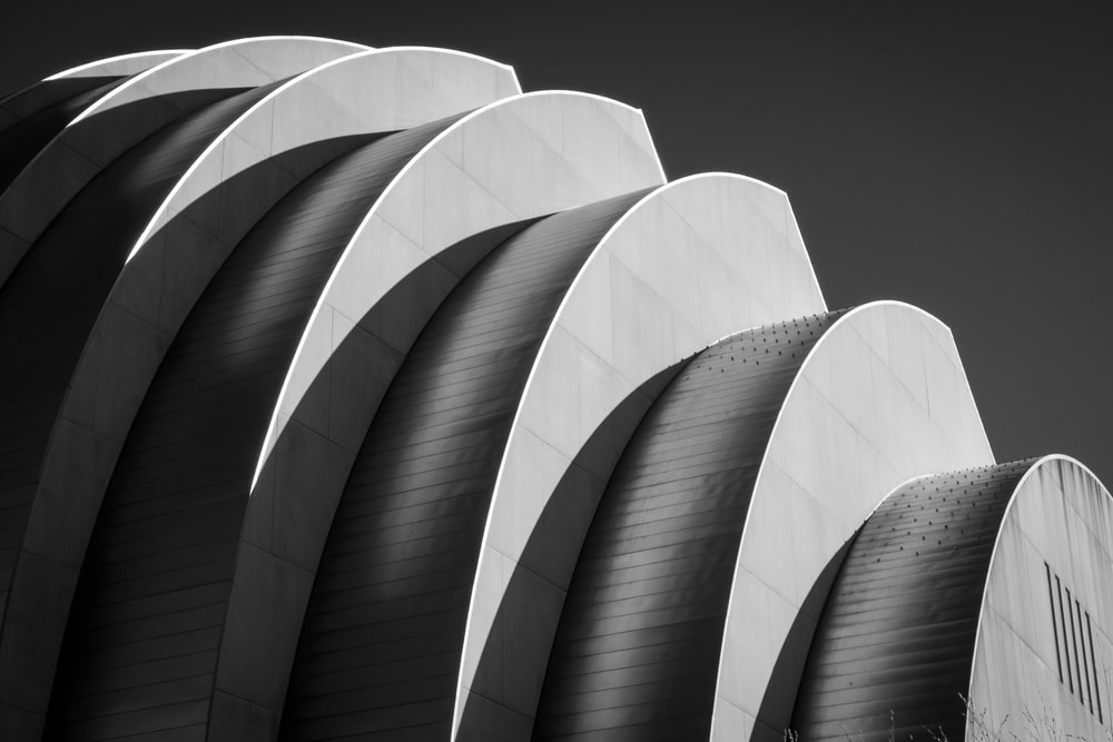 white spiral stairs in grayscale photography
