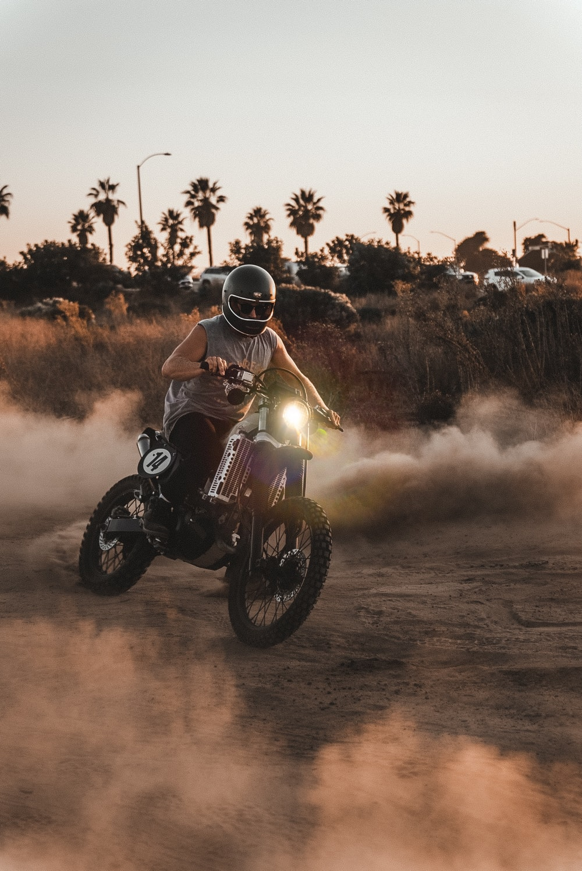 man in black helmet riding on black motorcycle