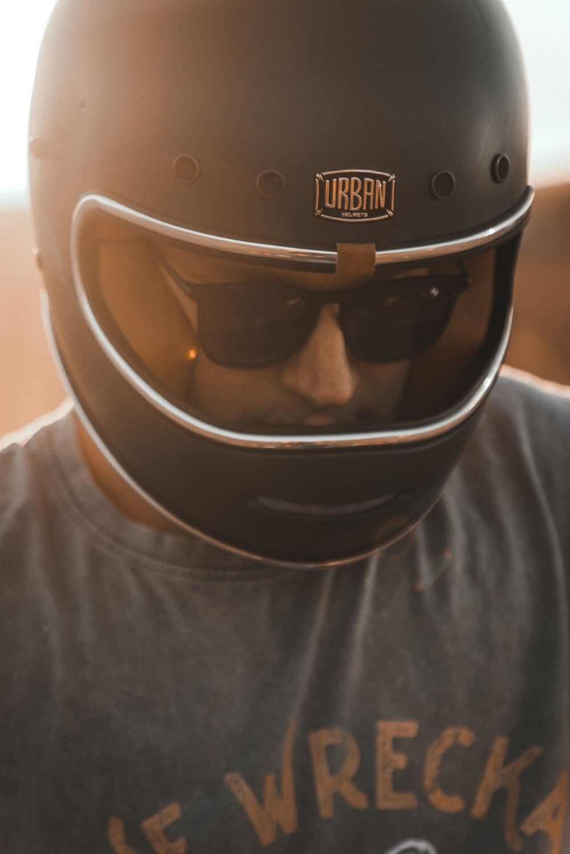 man in white crew neck shirt wearing black helmet