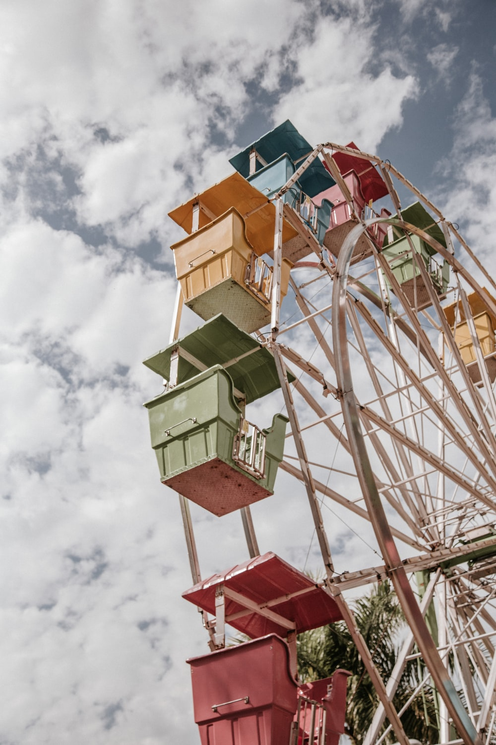 white red and yellow ferris wheel under blue sky during daytime