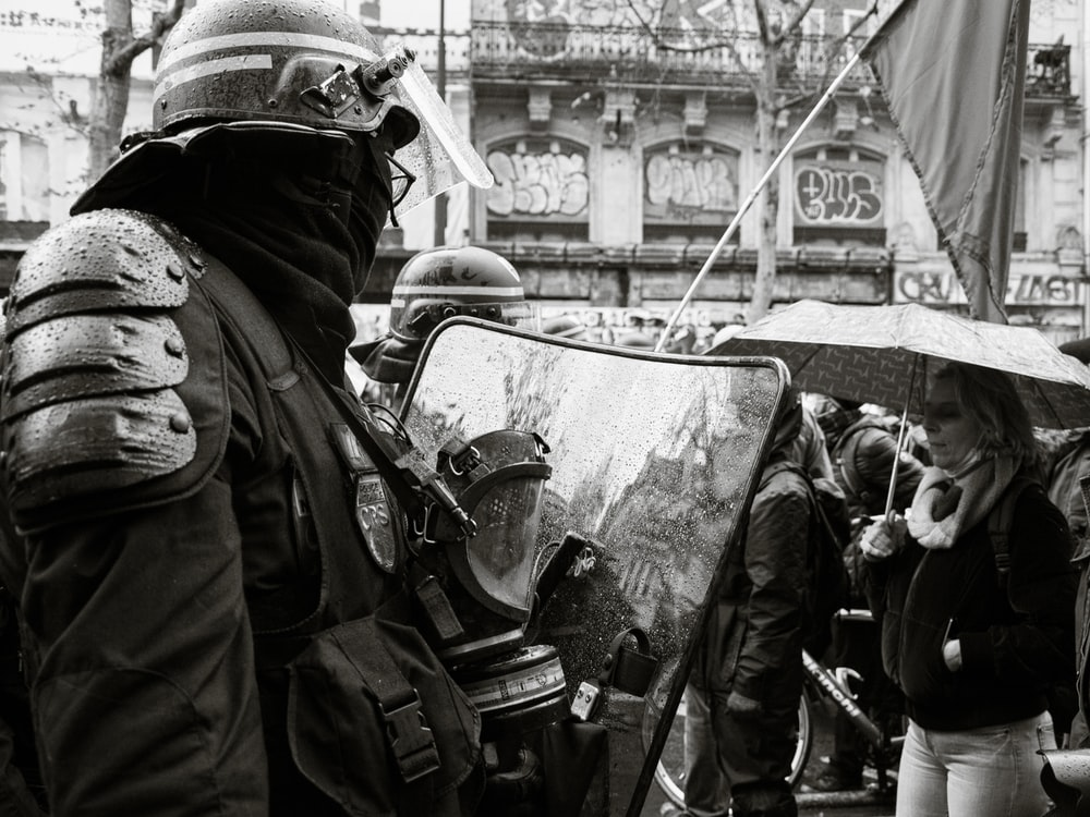grayscale photo of people in black uniform