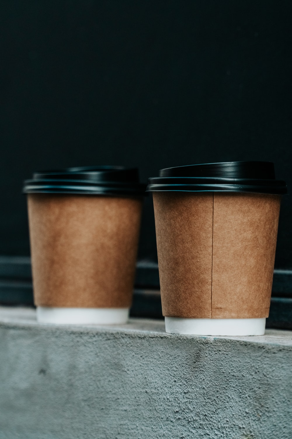 two brown and black plastic cups