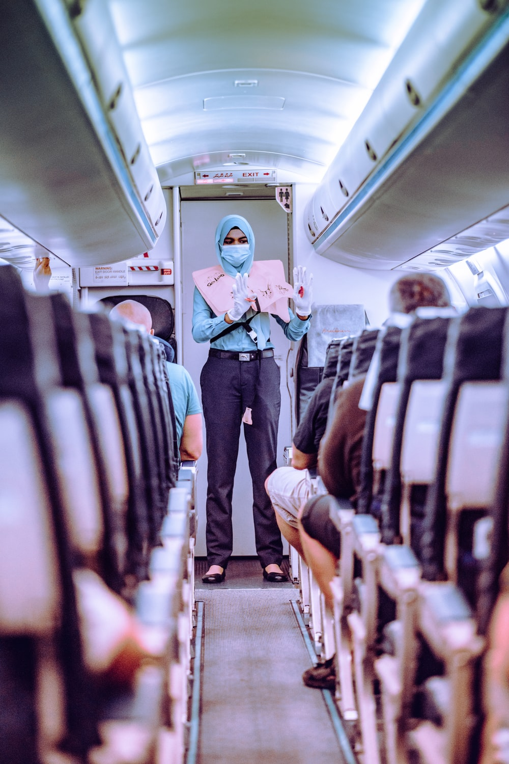woman in blue shirt standing in train