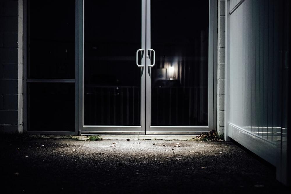 white wooden framed glass door