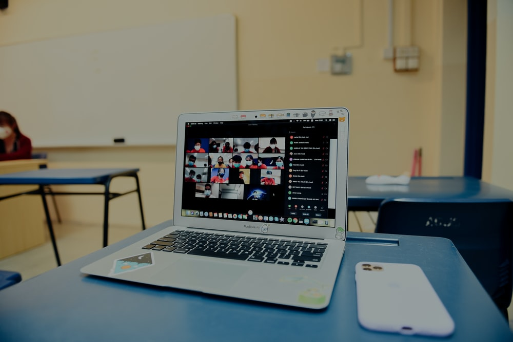 macbook pro on blue table
