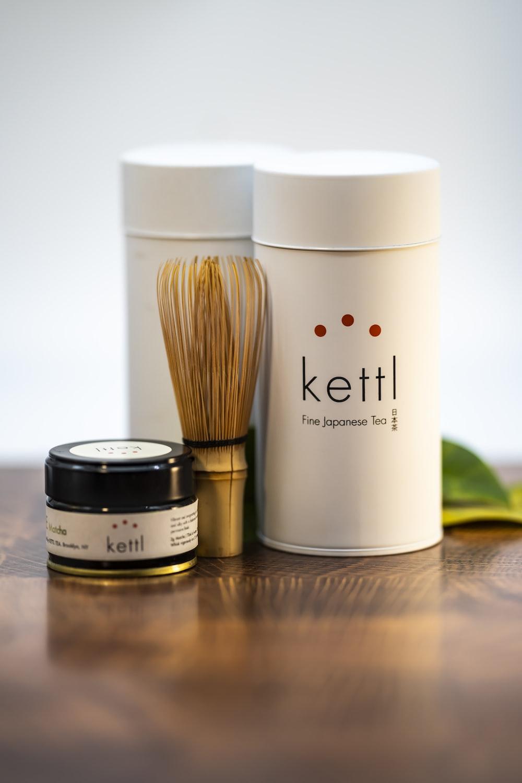 white and brown make up brush