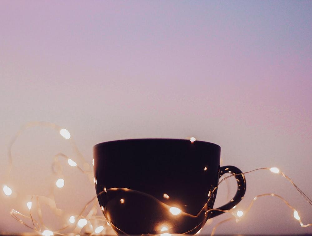black ceramic mug with water droplets
