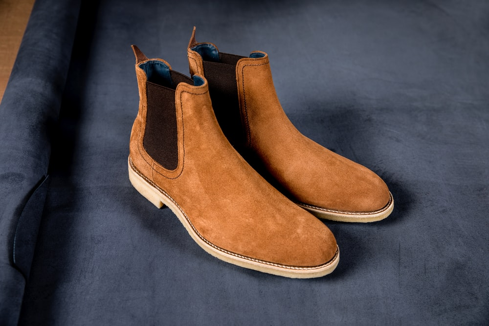 brown and white suede boots