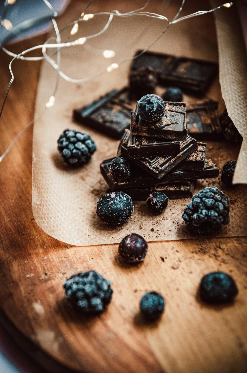 black berries on white paper
