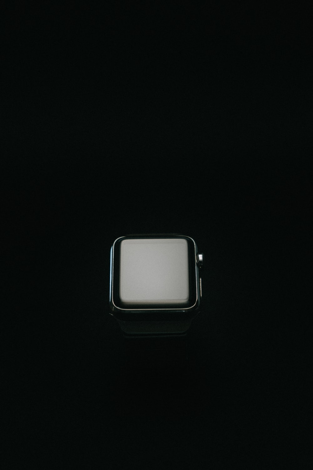 silver apple watch with white sport band