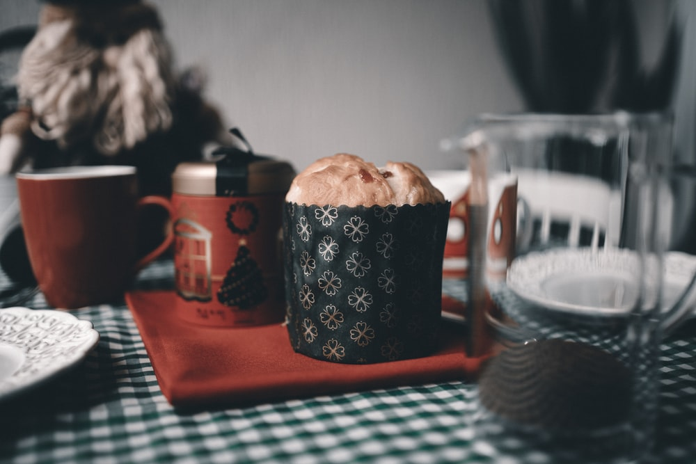 black and white ceramic mug on red tray