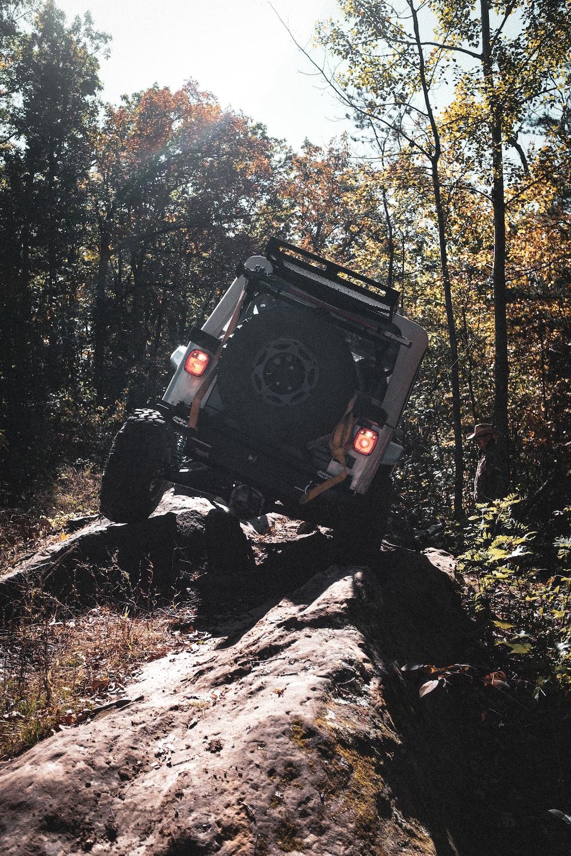black jeep wrangler on rocky road