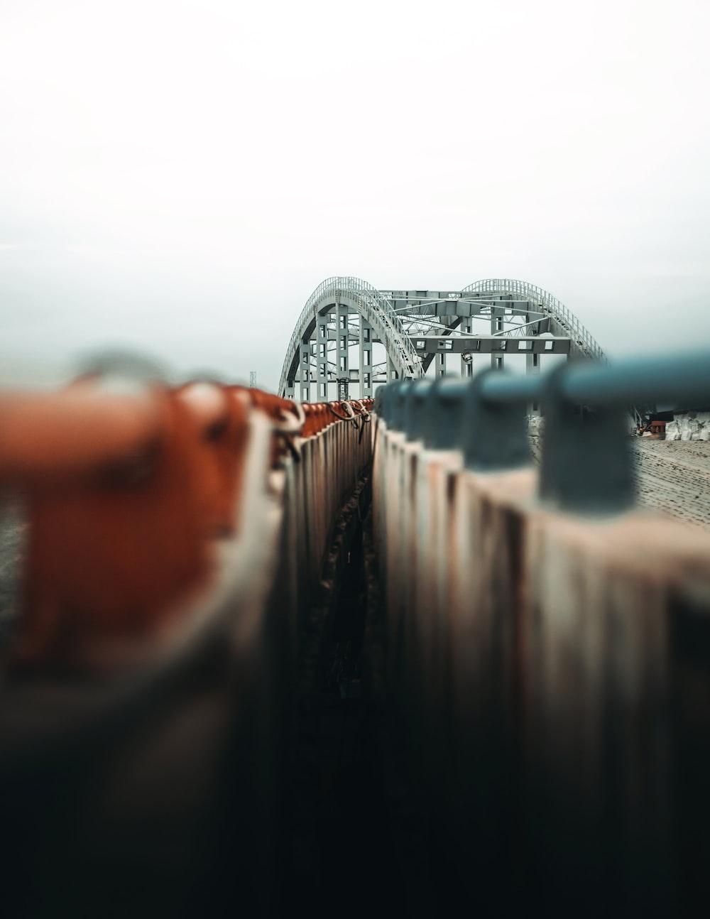 gray steel bridge over body of water during daytime