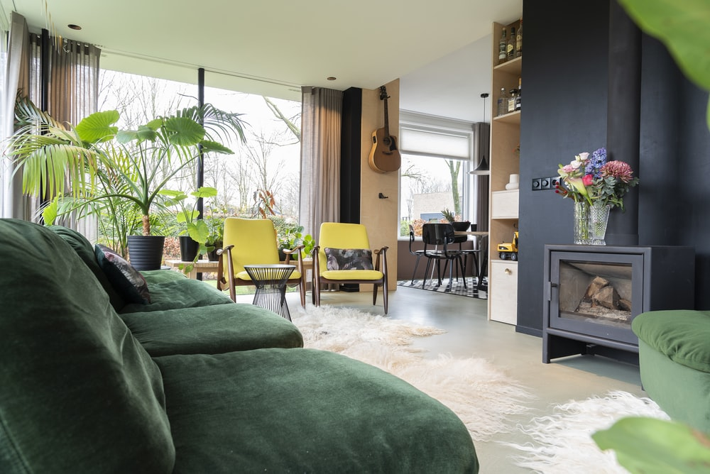 green sofa near brown wooden table