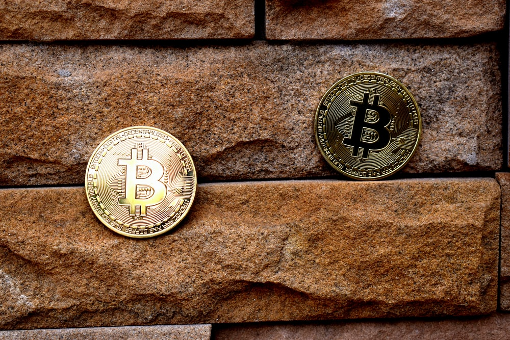 Two bitcoin, chilling on a wall