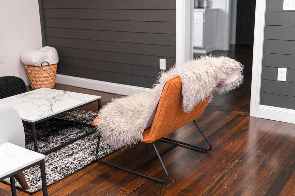 white fur textile on brown wooden chair