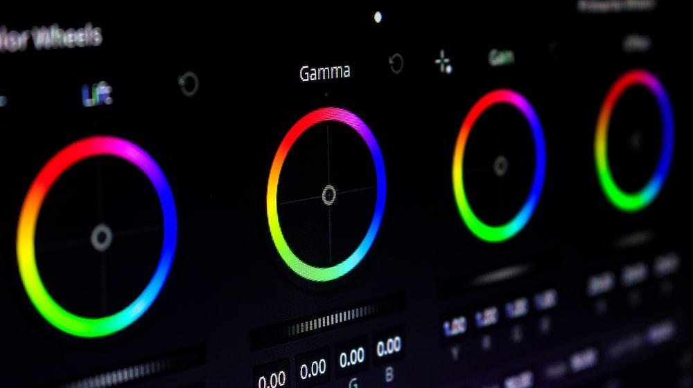 black green and purple digital device
