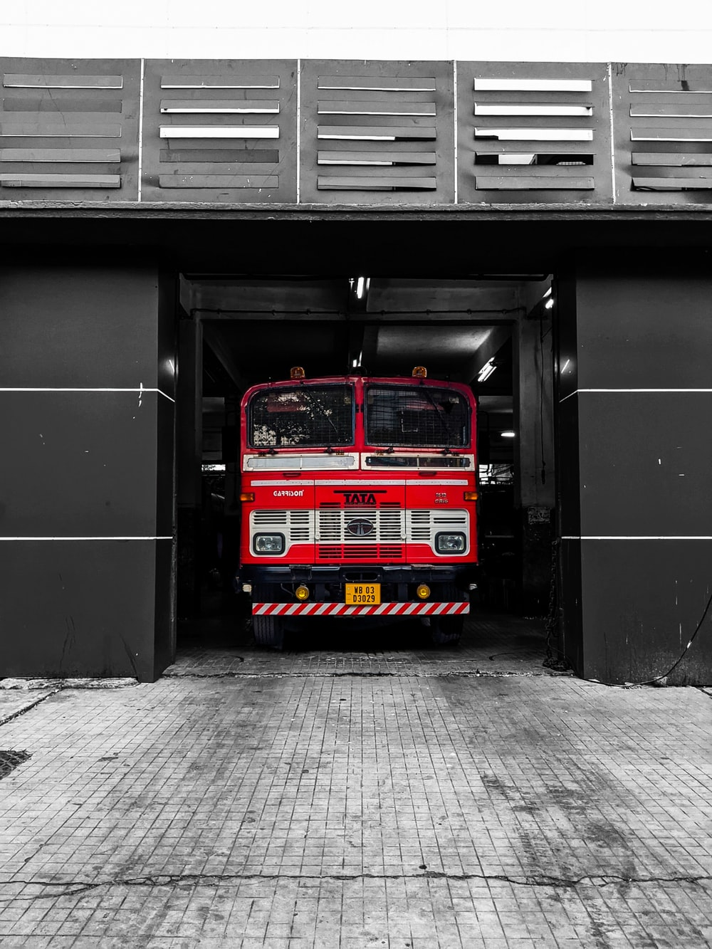 red blue and yellow bus in a tunnel