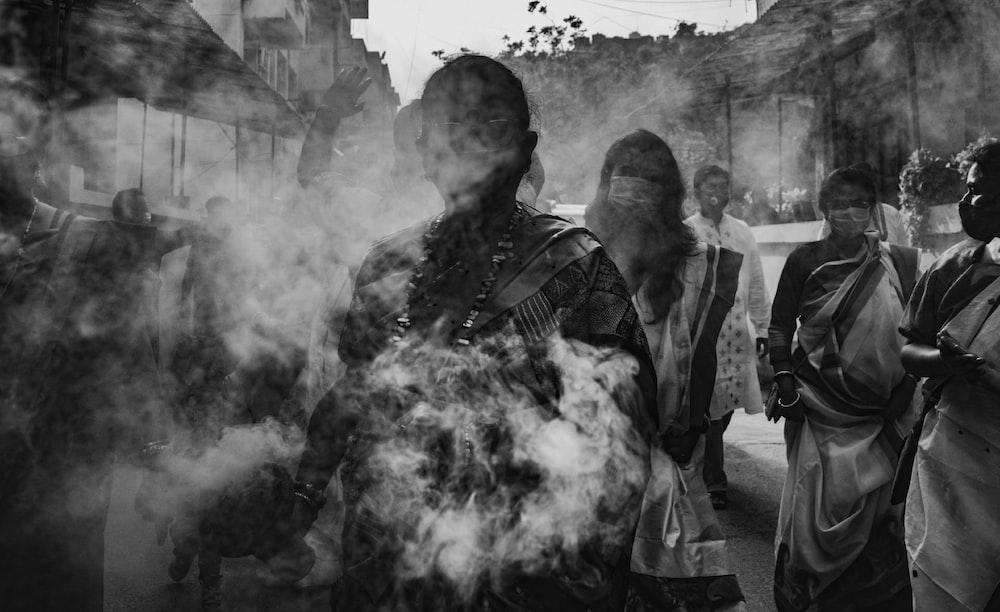 grayscale photo of man smoking
