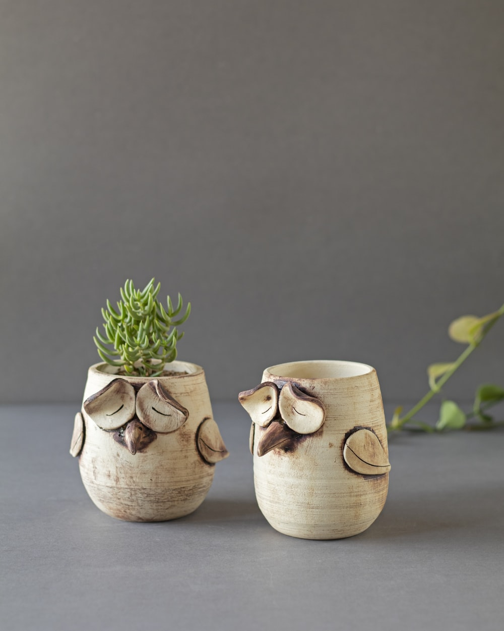 2 white ceramic mugs on gray table