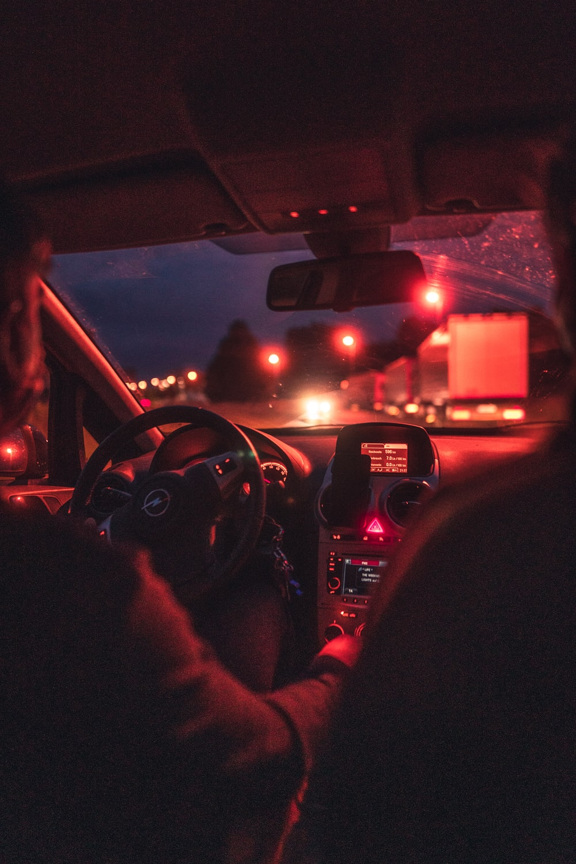 man driving car during night time