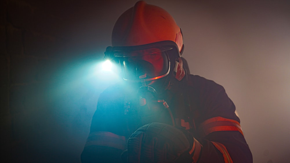 man in black jacket wearing black goggles and helmet