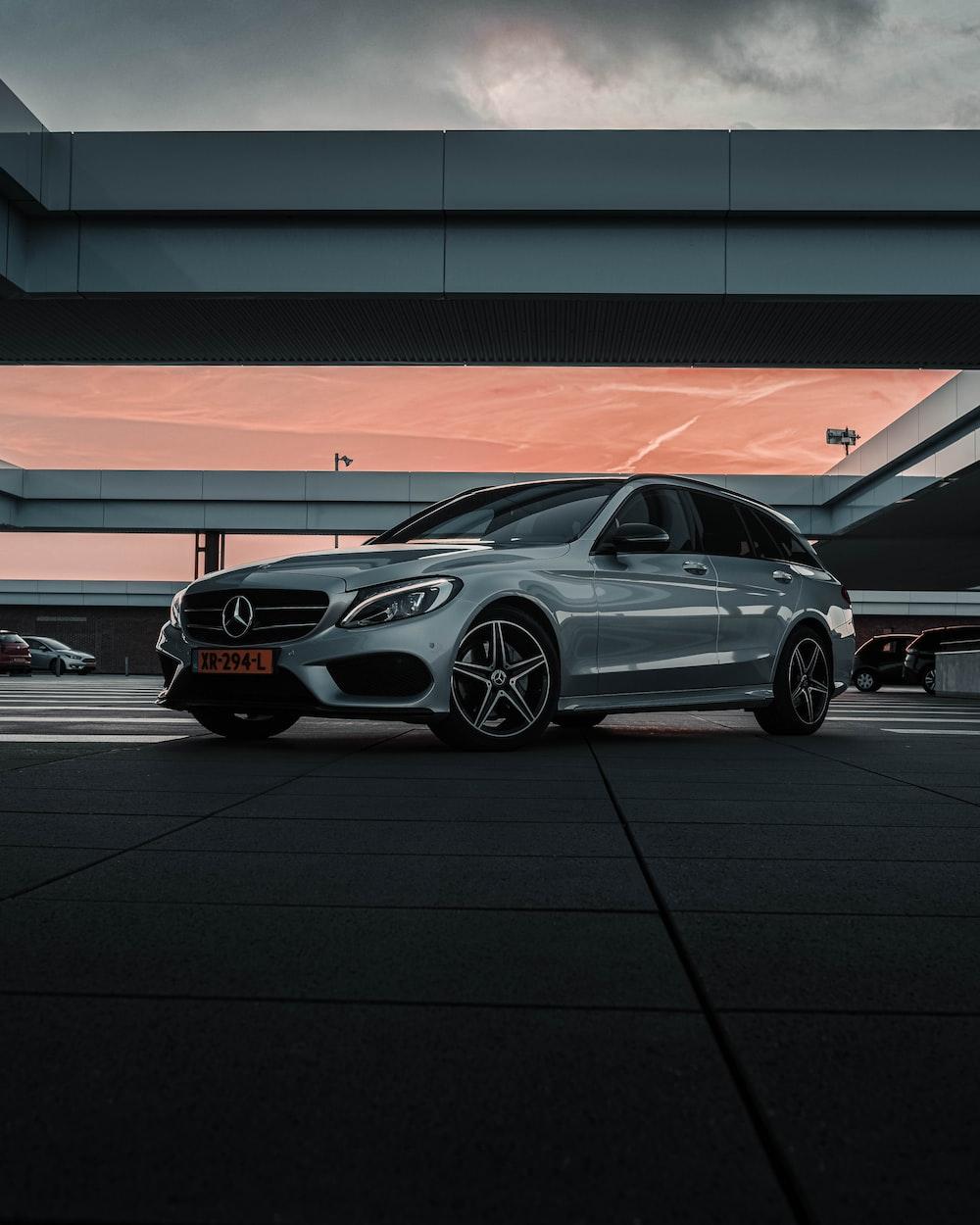 silver sedan on parking lot