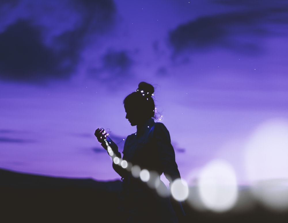 silhouette of man holding microphone
