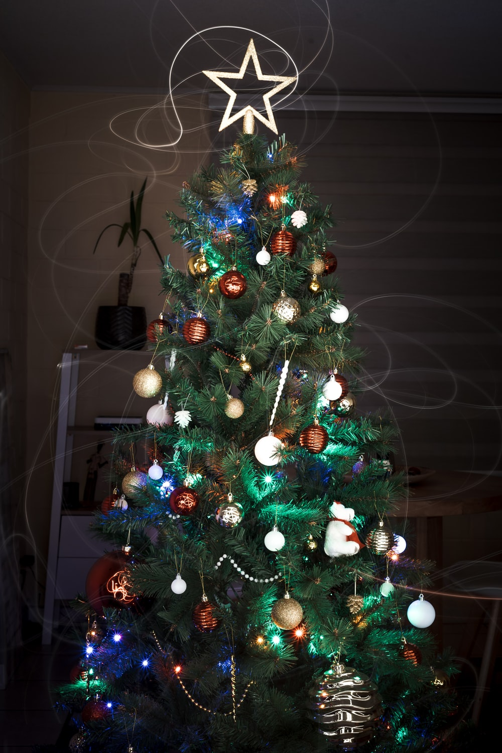 green christmas tree with baubles and string lights
