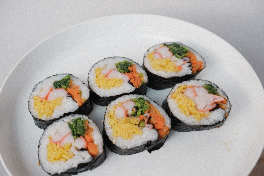 white ceramic plate with sushi