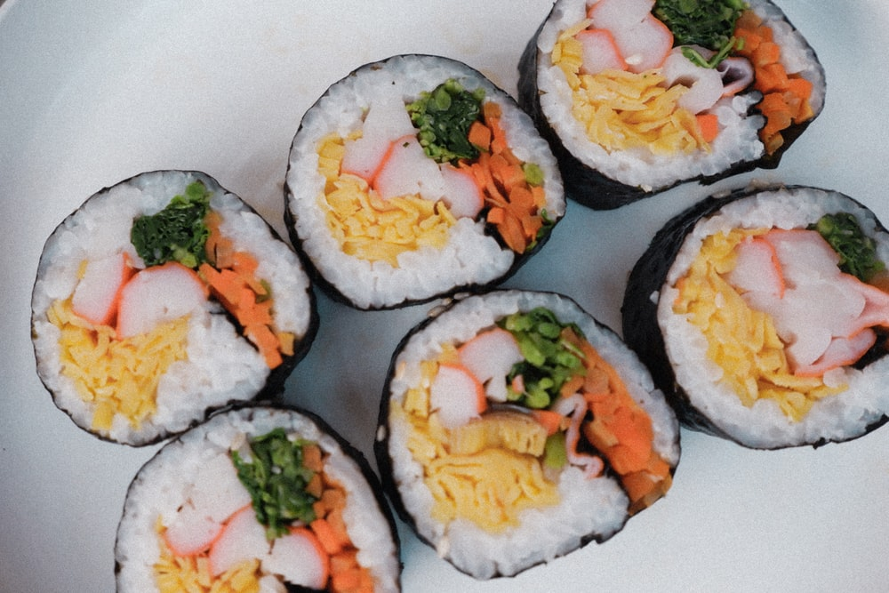 sushi rolls on white ceramic plate