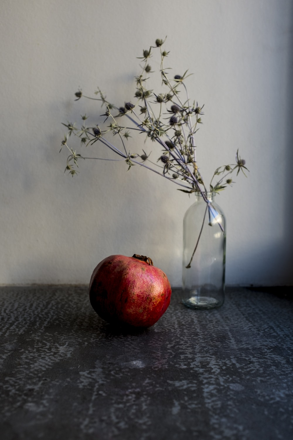 red apple fruit on clear glass vase