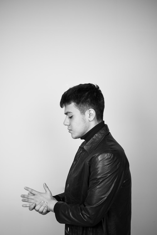 man in black leather jacket