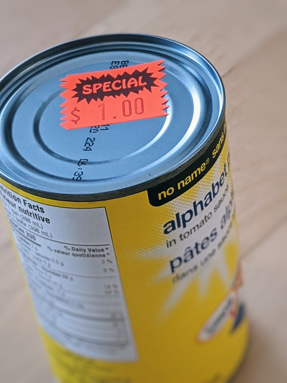 yellow and white labeled can
