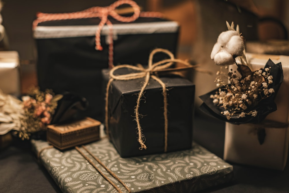 black and brown gift box on white and black floral textile