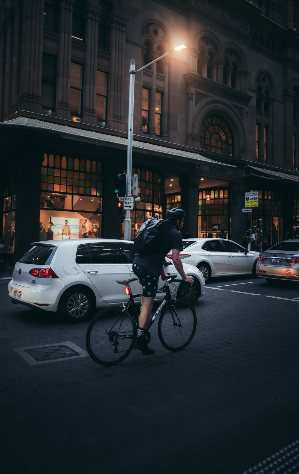 man in black jacket riding bicycle on road during daytime