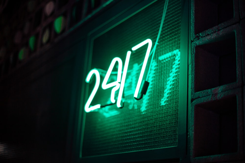 green and white open neon light signage