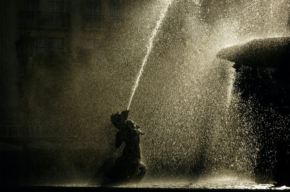 water fountain in grayscale photography
