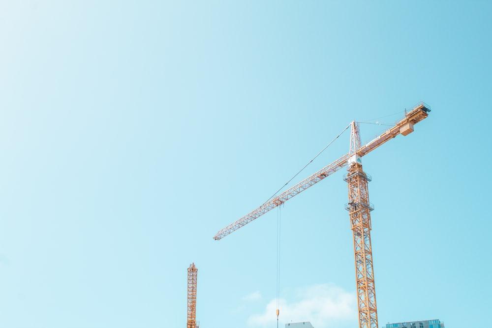 orange crane under white sky