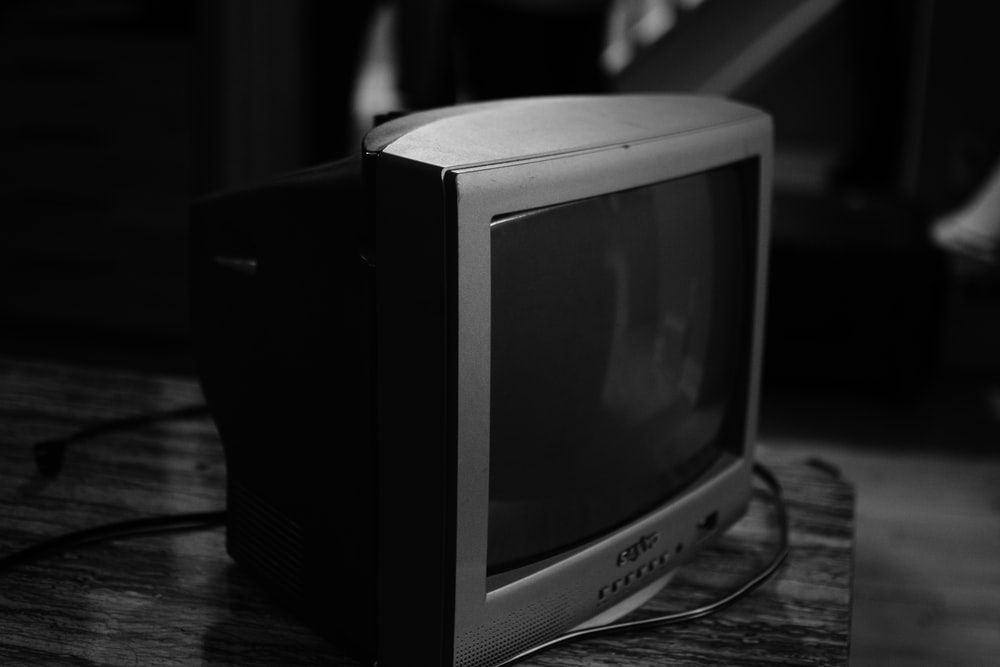 gray crt tv on brown wooden table