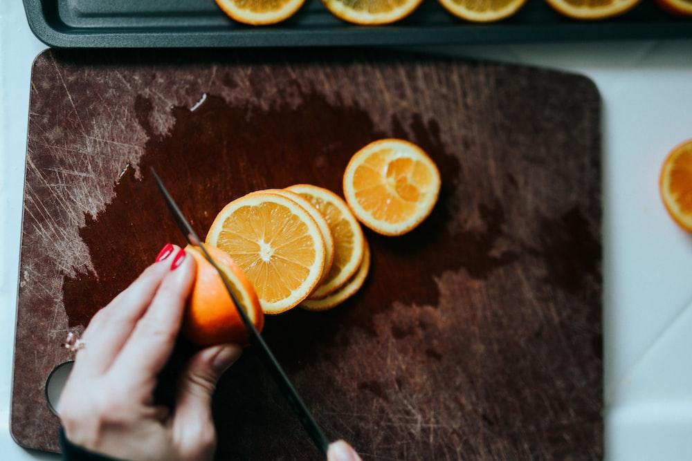 sliced lemon on brown wooden table