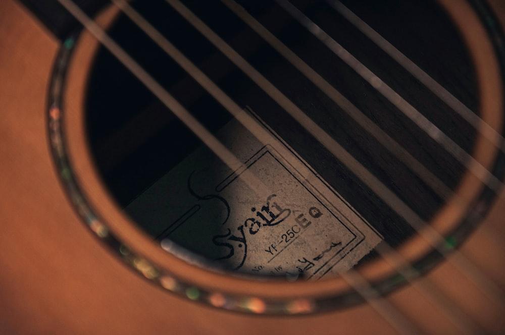 brown acoustic guitar with black guitar print