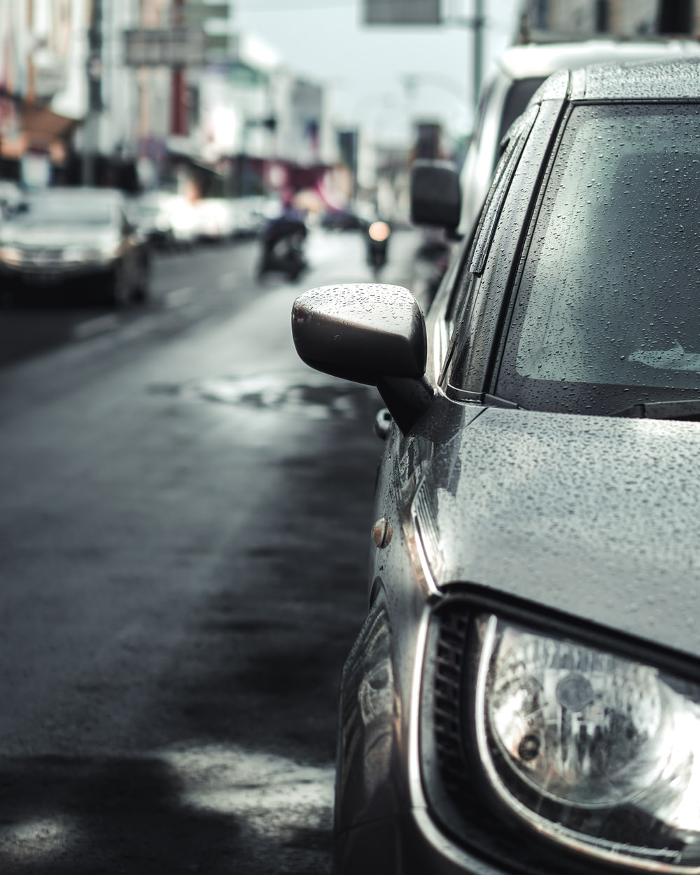 black car on the street during daytime