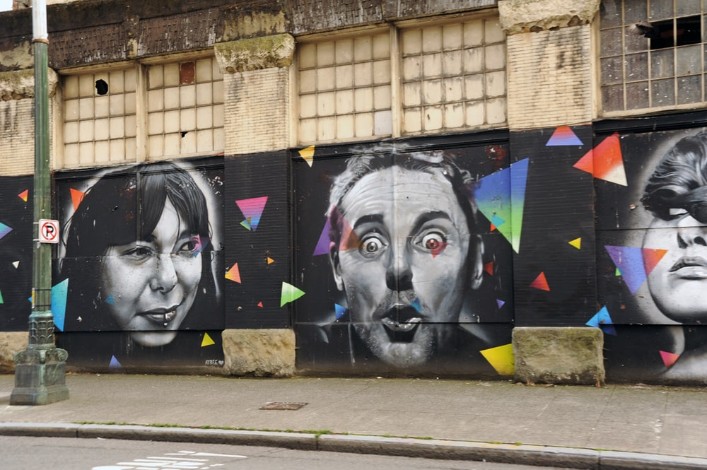 black and white human face graffiti