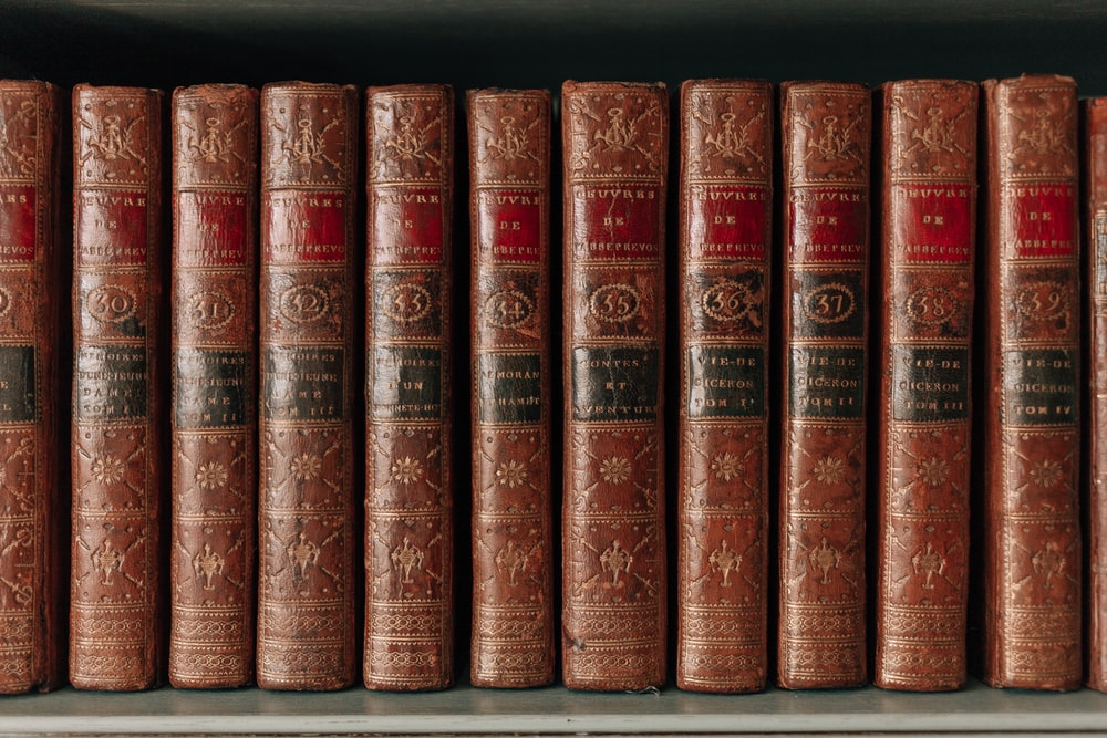 piled of red hardbound books