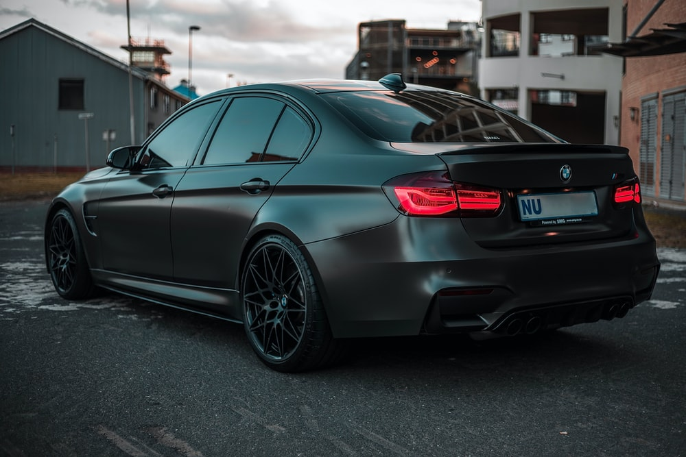 black bmw m 3 coupe parked on parking lot during daytime