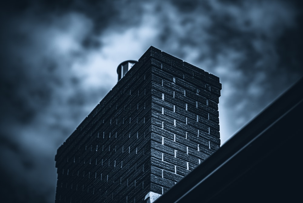 brown brick building under cloudy sky