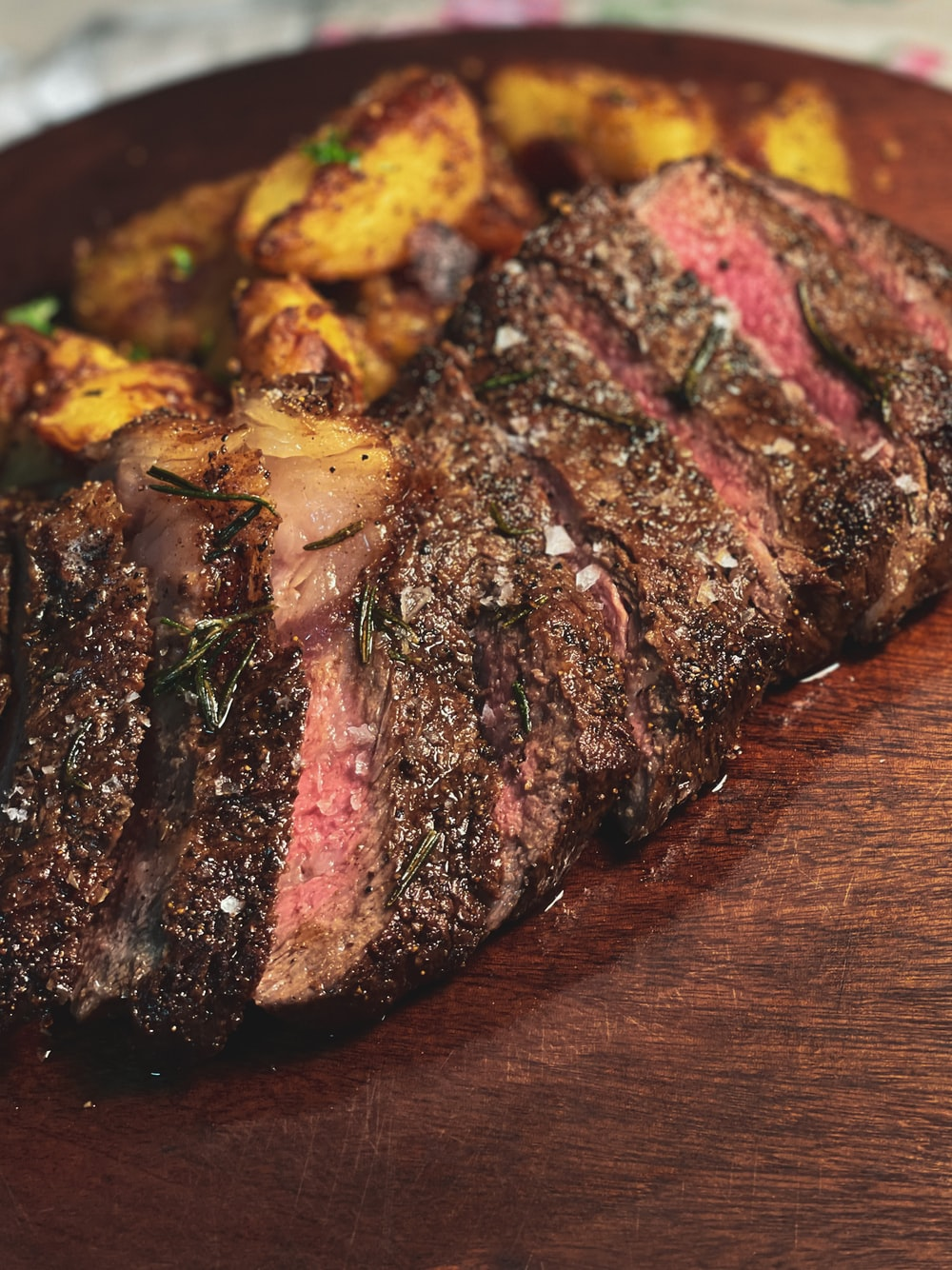 grilled meat on brown wooden table