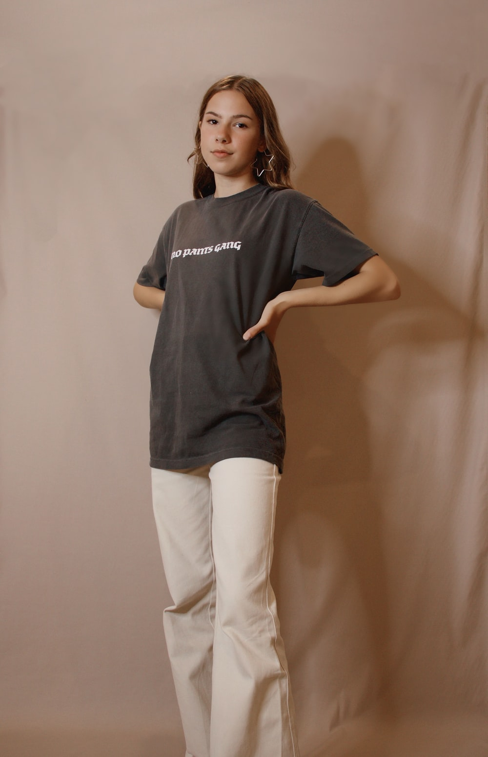 woman in black crew neck t-shirt and white pants